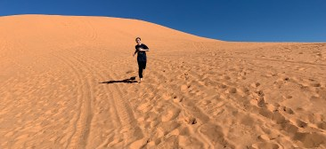 Carter Bourn Running Down the Coral Pink Sand Dunes
