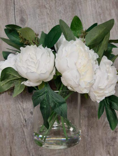Peony arrangement in vase