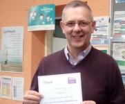 Carl receives Community development award
