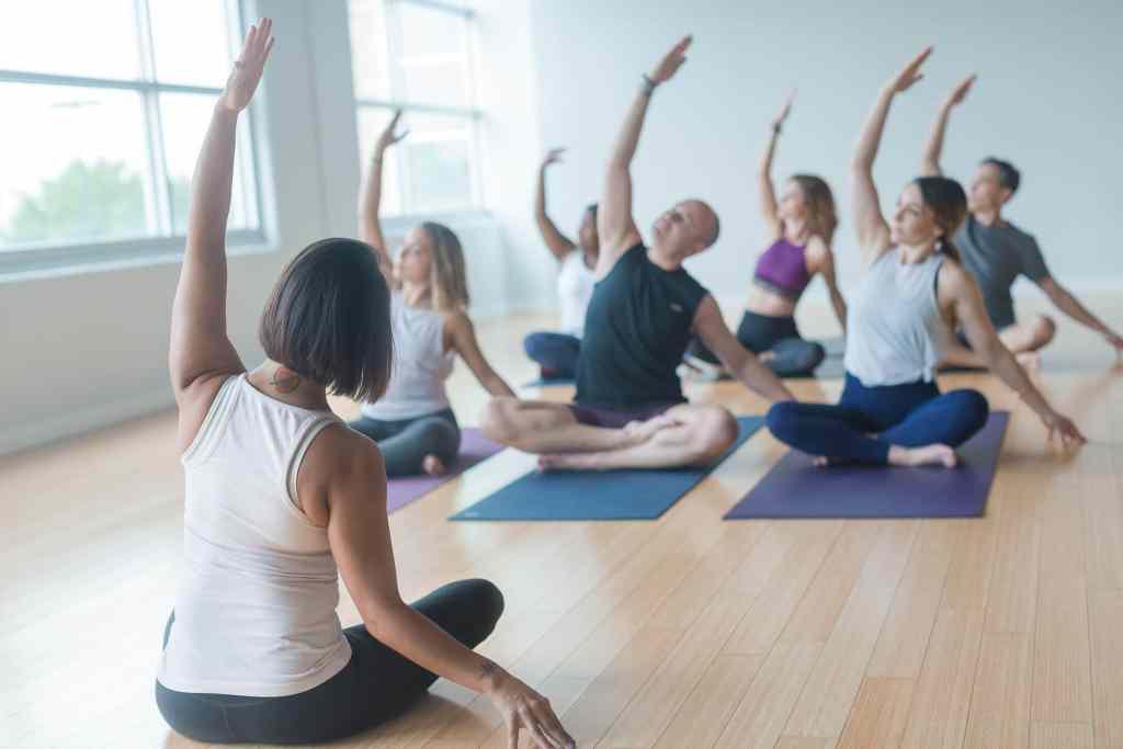 Inspire Yoga Teacher Training class seated arm raised