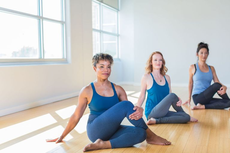 students in seated yoga position