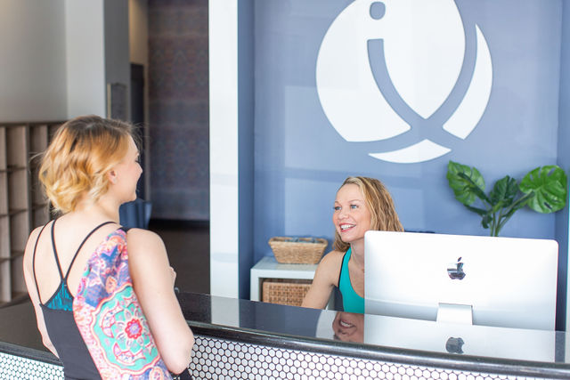 Yoga Student Checking In Inspire Yoga Colleyville Front Desk