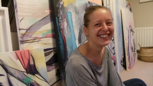 Hannah Adamaszek at home with Canvases ready for the show