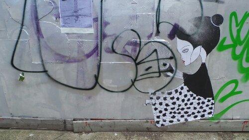 A lady sitting down on White Post Lane