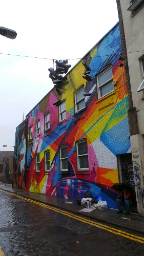 MadC's huge mural dominates the street