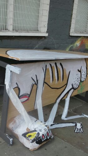 An old table awaiting collection on Club Row has received the 'Art is Trash' makeover