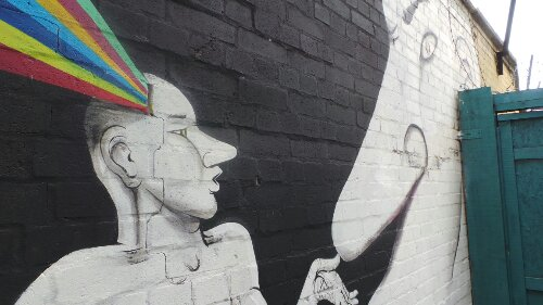 A closer view of the RUN mural in the yard