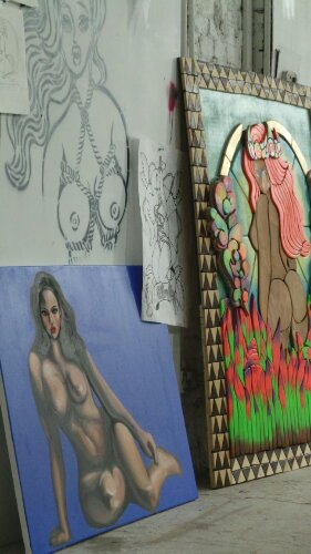 Saki uses many different mediums here she has examples of wood, oil and stencil art