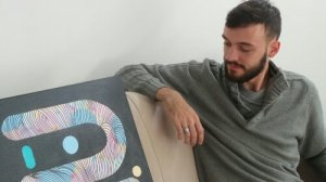 Kef at home with one of his abstract canvases