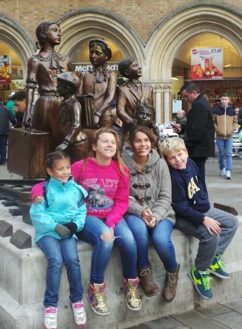 Children pose by the Kindertransport statue.  This is where we start our walking tour of the East End of London