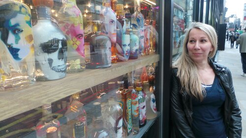 """Yvonne Wayling admires her bottles in the window """"it's been a rewarding experience"""" she told me"""