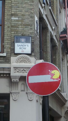 A Pac Man eating the sign on Sandy's Row