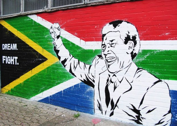 French artist Zabou painted this tribute to Mandela in Acton, London sporting an iconic pose and with the South African flag in the background