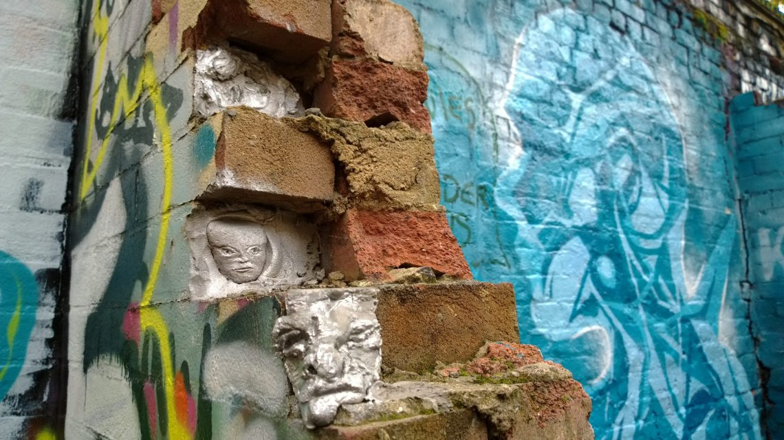 Some subtle Jonesy sculptures sneaking their way out of a wall on Brick Lane