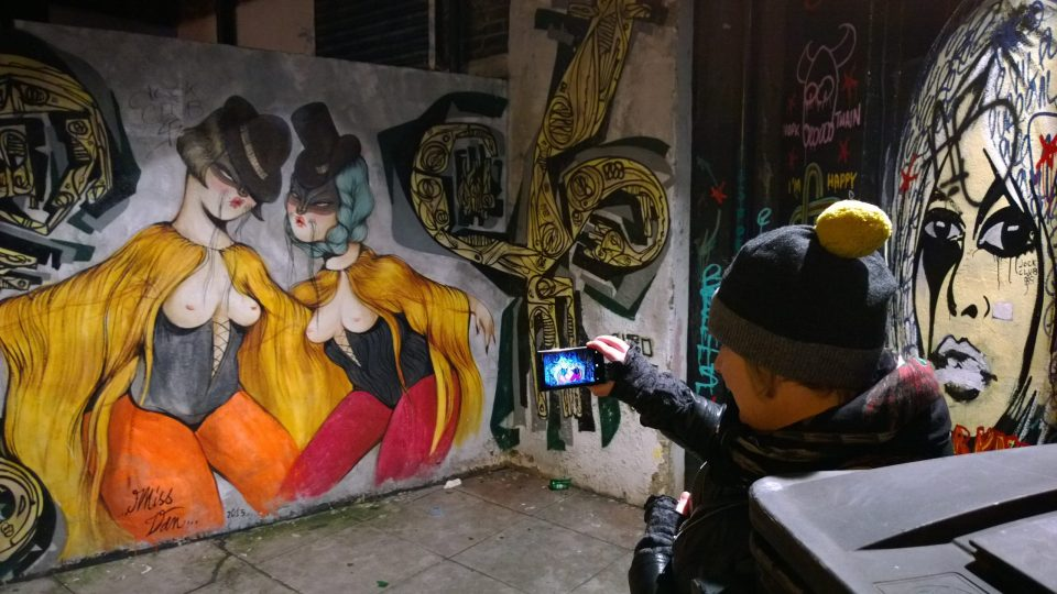 Picture taking at night in a rather dingy section of town.  The art featured is from the iconic French artist Miss Van