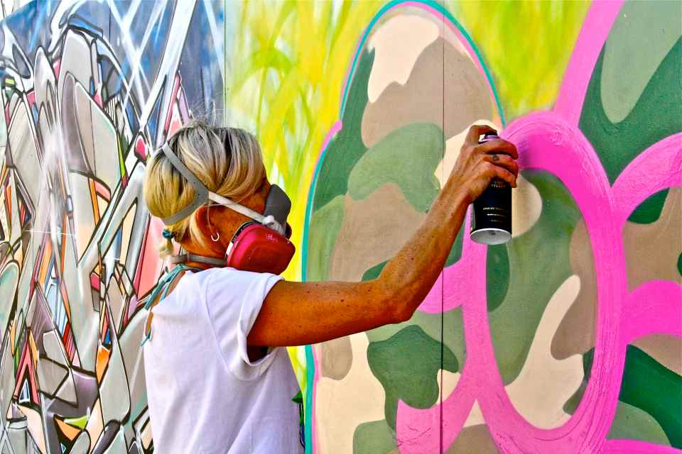 Steffi in action painting Camo Bow