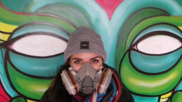 Amara painting in an abandoned building in Bow