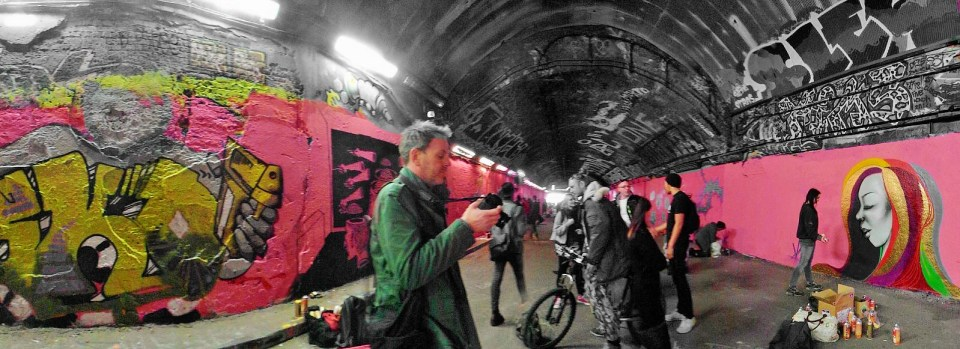 The Leake Street graffiti tunnel packed out with artists and photographers