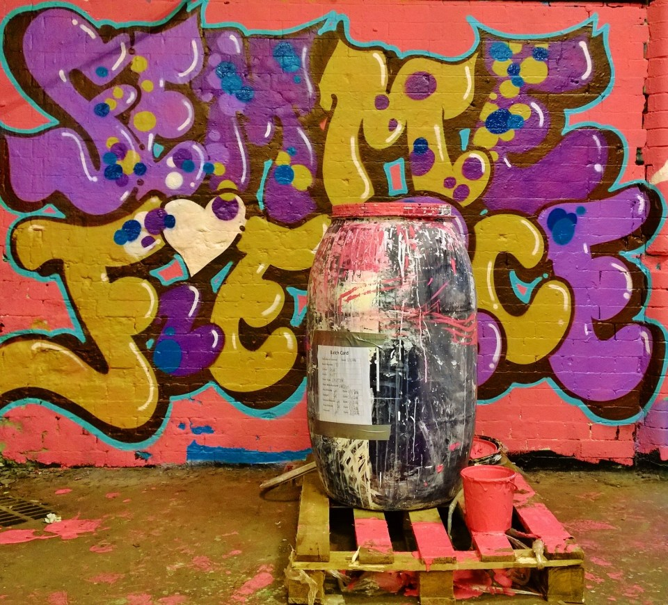 I love how this barrel of pink paint looks next to the Femme Fierce mural