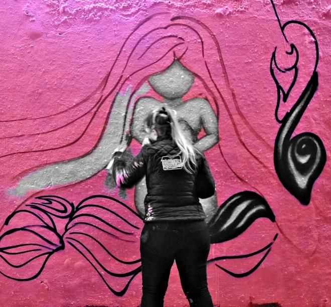 Vanessa Longchamp in action painting one of her distinctive ladies