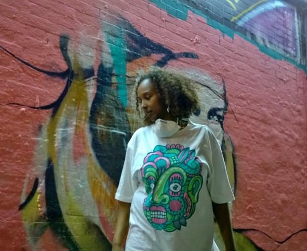 Ayaan Bulale from the Street Art Agency next to work from Hannah Adamaszek