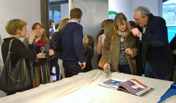 People admiring the book