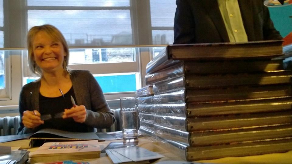 Ingrid signing copies of the book
