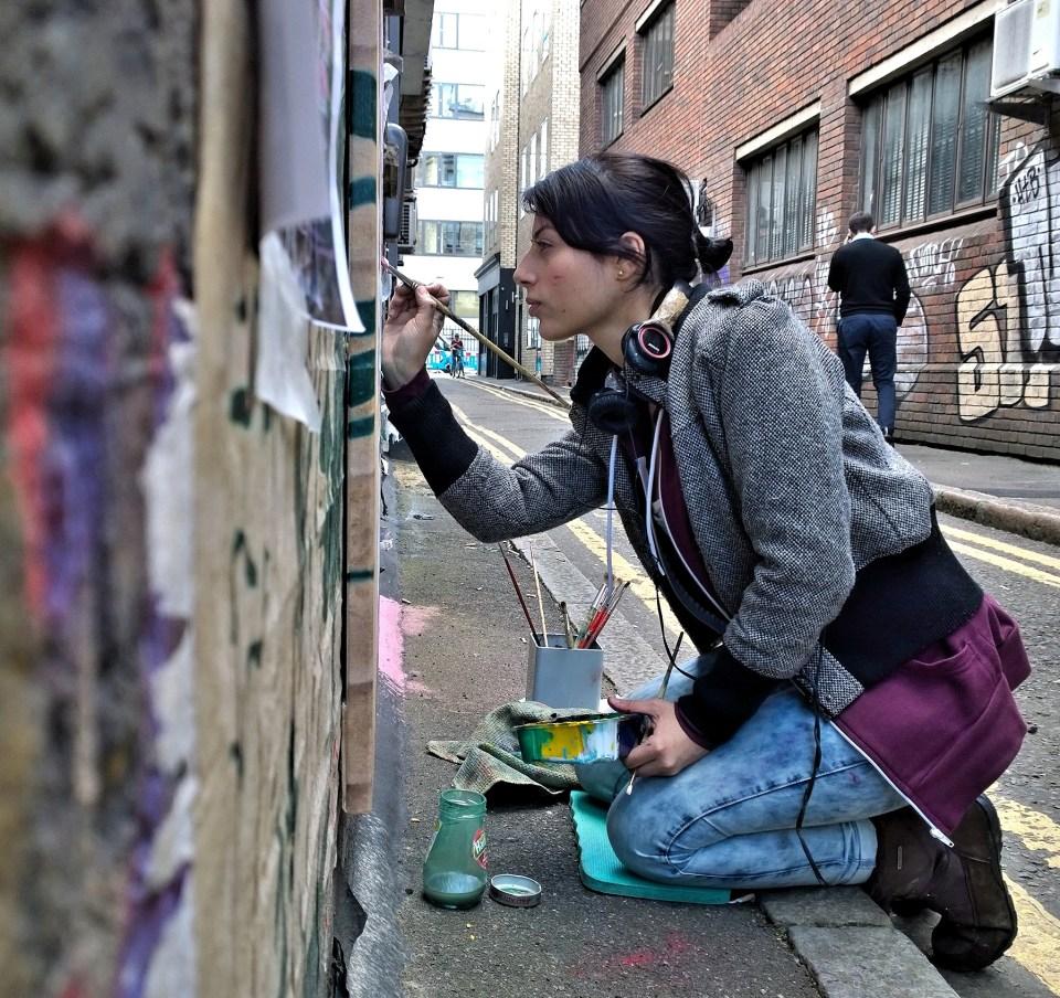 Andrea painting on Blackall Street