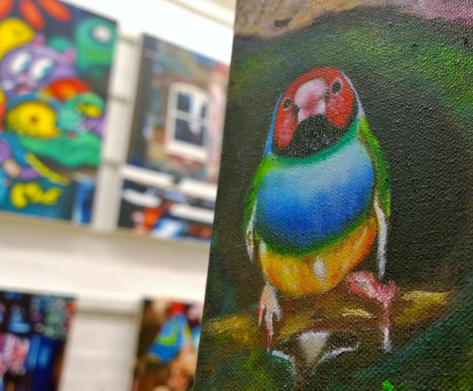 A little bird oversees the art in the studio