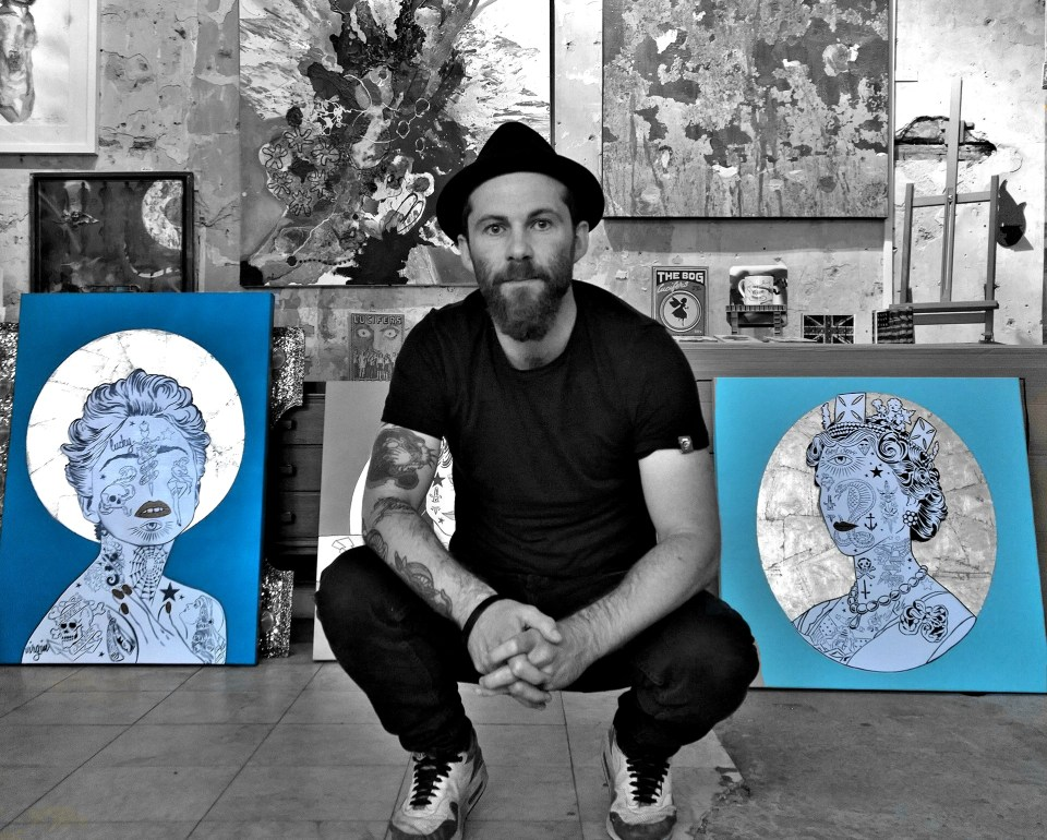 In the studio with his canvasses of Madonna and the Queen