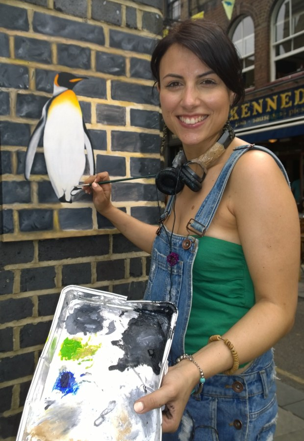 Andrea Tyrimos next to her latest painting on Whitecross Street