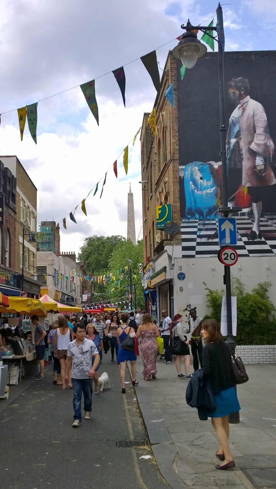 Whitecross Street with the imposing mural from Conor Harrington