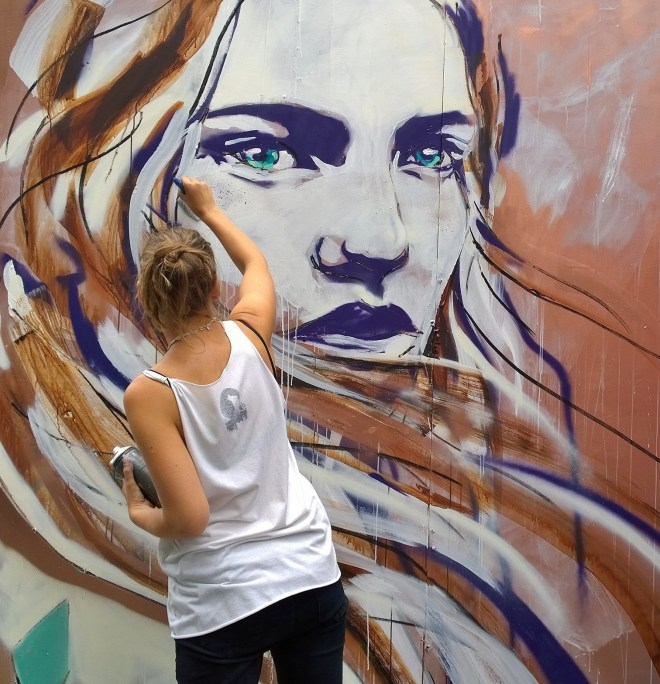 Hannah Adamaszek painting during the Whitecross Street festival.