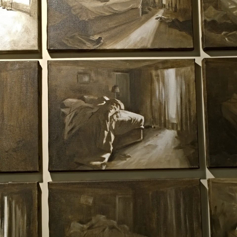 'PTSD' by Arabella Dorman.   A series of nine paintings of a bed in a hotel room in various states of disarray.