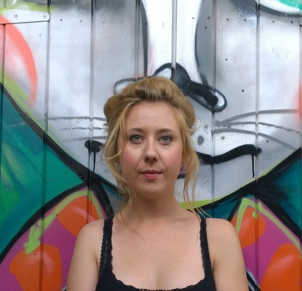 Anna next to one of the painted sheds in Camden, with art from Spanish artist Elno