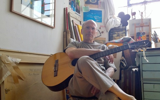 Artist Paul Norton entertained guests with his guitar
