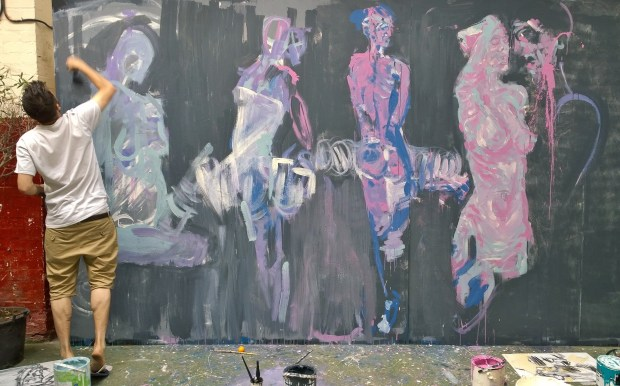 Neoh painting in one of the open studios