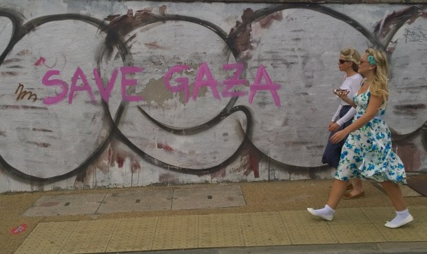 Save Gaza tag written on the walls of the Crate Brewert