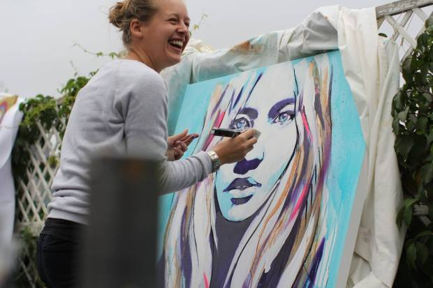 Hannah Adamaszek live painting on the roof courtesy of  International Alert