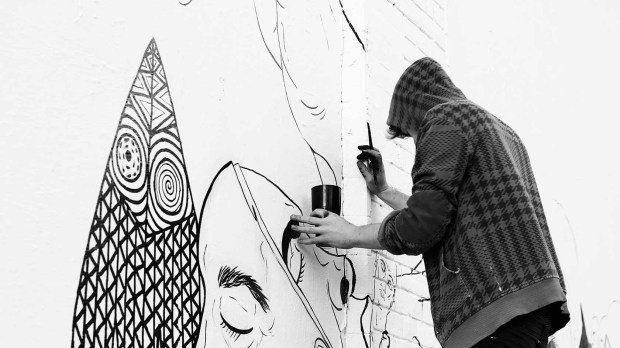 Benjamin Murphy painting the Shoreditch Art Wall.  Photo courtesy of Daniel Lucas