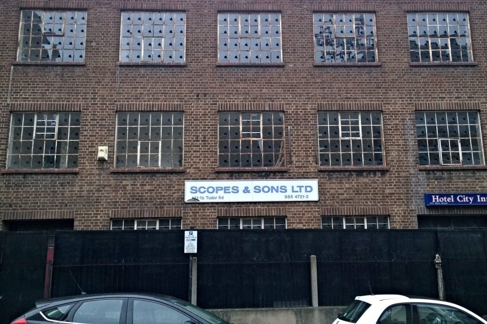 Look closely and each window on this warehouse building in Hackney has been smashed in the same way