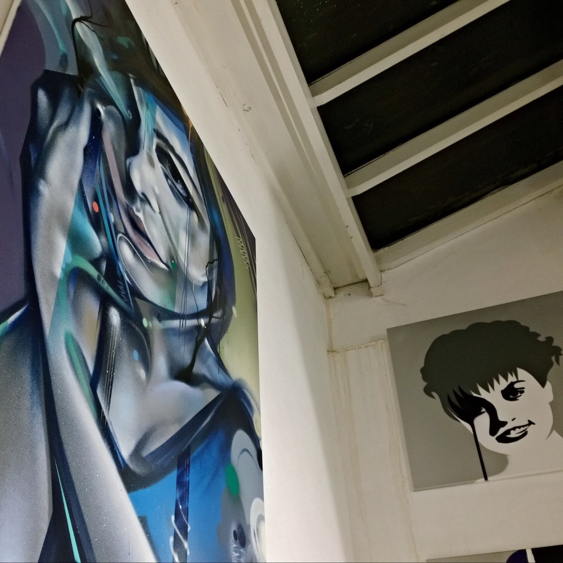Mr Cenz art with work from Pure Evil in the background