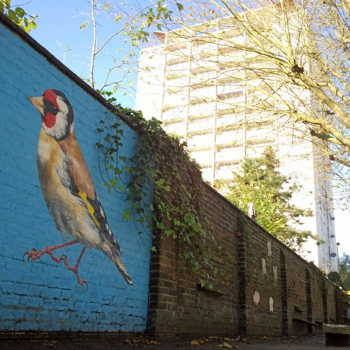 Painting of a goldfinch in the grounds of berrymede school