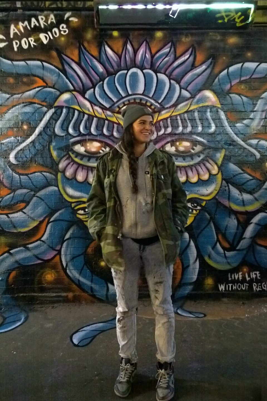 Amara Por Dios next to a tribute to Ben Naz in the Leake Street Tunnel