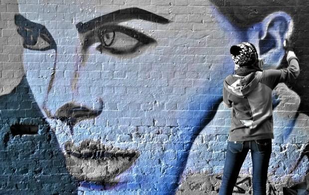 Norwegian artist Zina painting in the Leake Street tunnel