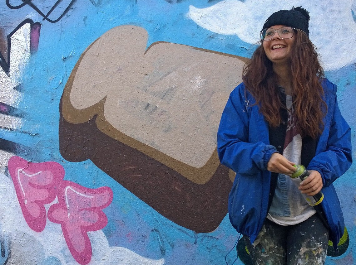 Artista painting toast in the Leake Street Tunnel