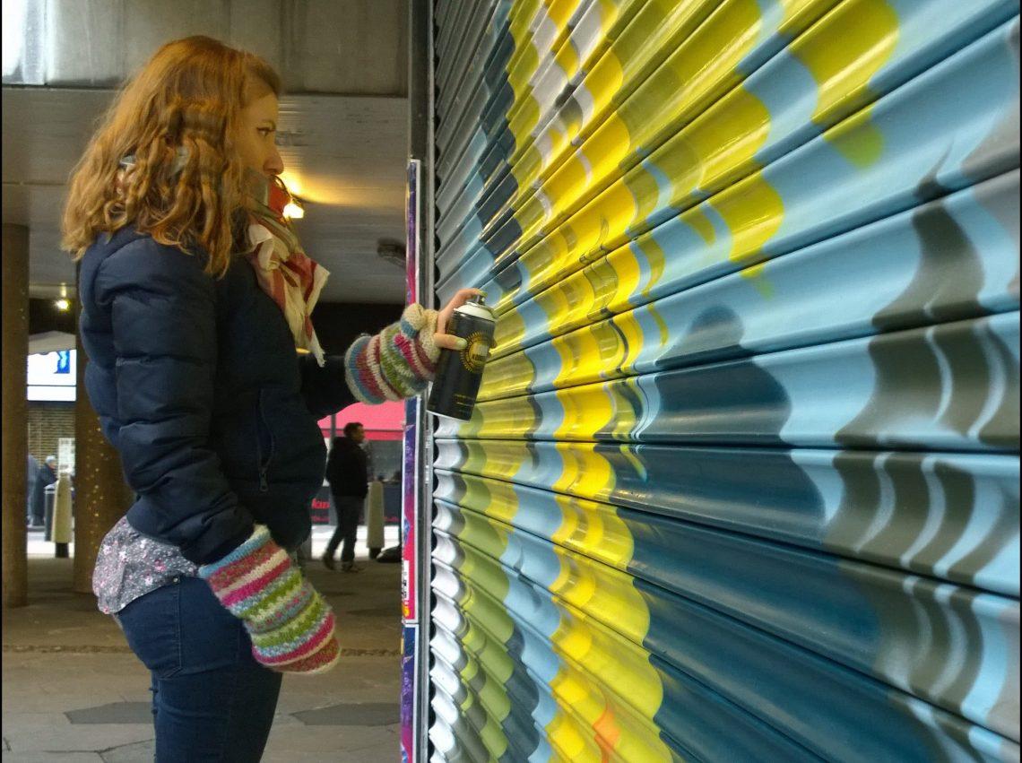 Adriana Doi painting at the Croydon paint jam