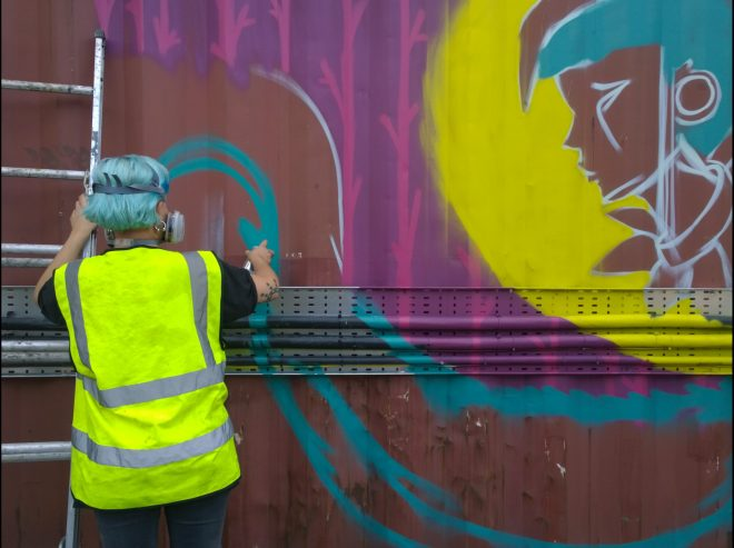 Elno mid way through her mural