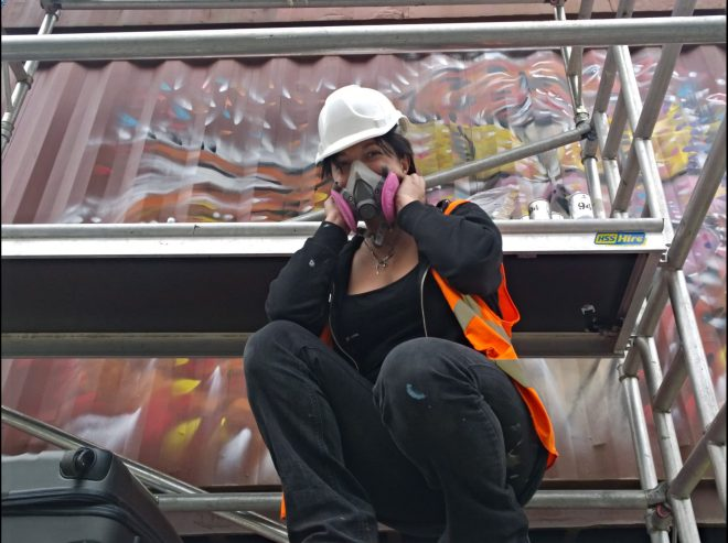 Giusi Tomasello working high up on the scaffold in Brixton