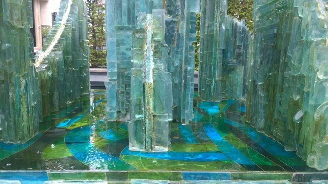 A close up of the detail work within the glass fountain